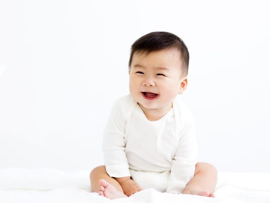 Adorable asian smiling baby boy