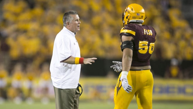 ASU head football coach Todd Graham talks with ASU linebacker Salamo Fiso during the third quarter of the college football game at Sun Devil Stadium in Tempe on Saturday, September 12, 2015. ASU won the game 35-14.