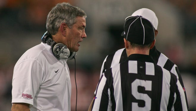 Iowa Hawkeyes head coach Kirk Ferentz talks to referees during the fourth quarter of the TaxSlayer Bowl. Tennessee beat the Iowa 45-28. The Hawkeyes are 26-25 in the last four seasons under Ferentz and have not been ranked during that time.
