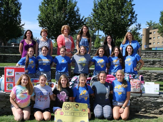 The Misericordia University campus community collected school supplies as part of the annual 'Stuff the Bus' project for Mercy Week. Participating in the drive, first row from left, are cheerleaders Gabriella LaManna of Hillsborough; Carrie Kinney of Hunlock Creek, Pennsylvania.; Cori Aull of Newton; Jackie McClintock of  Muncy Valley, Pennsylvania; Abrielle Garber of  Hanover Twp., Pennsylvania., and Bailey Klein of Rocky Point, New York; second row, Kristin Robinson of Harleysville, Pennsylvania; Stephanie Monforte of Staten Island, New York; Shannon Wittreich of  Northampton, Pennsylvania; Brittany Nastawa of  Hudson, Pennsylvania.; Jenna Chilcote of Millville, Pennsylvania.; Samantha Olcott of Monroe Twp., and Olivia Cottle of  Manheim, Pennsylvania.; third row, community fiscal committee members Leslie Risko, staff accountant; Georgia Young, administrative assistant, campus ministry; Kathy Zawatski, administrative assistant, student success center; Christine Marks, assistant director, admissions; Elizabeth Pedro, technical administrator, information technology, and Sue Lazur, administrative assistant, Mary Kintz Bevevino, Library.
