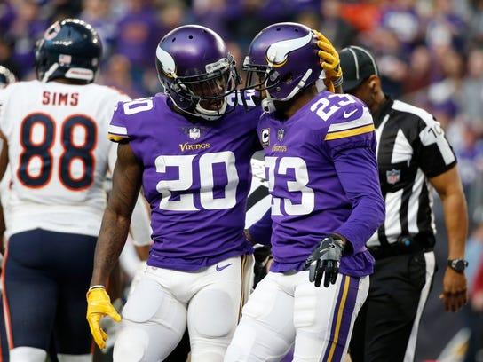 Minnesota Vikings cornerback Mackensie Alexander (20) celebrates with teammate Terence Newman (23) during the second half of an NFL football game against the Chicago Bears, Sunday, Dec. 31, 2017, in Minneapolis. (AP Photo/Bruce Kluckhohn)