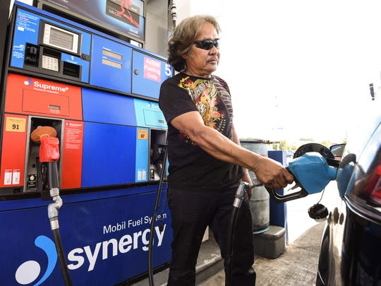 Dededo resident Jerry Maglonza stops to refuel his vehicle at a Mobil service station in Tamuning on Tuesday, Jan. 9, 2018.