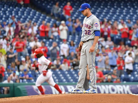 New York Mets starting pitcher Steven Matz (32) waits on the mound after giving up a home run to Philadelphia Phillies center fielder Odubel Herrera (37) during the first inning at Citizens Bank Park.