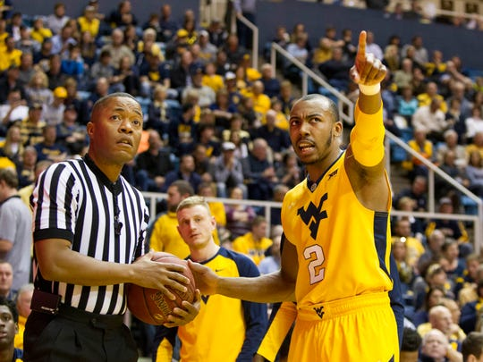 West Virginia Mountaineers guard Jevon Carter (2) talks