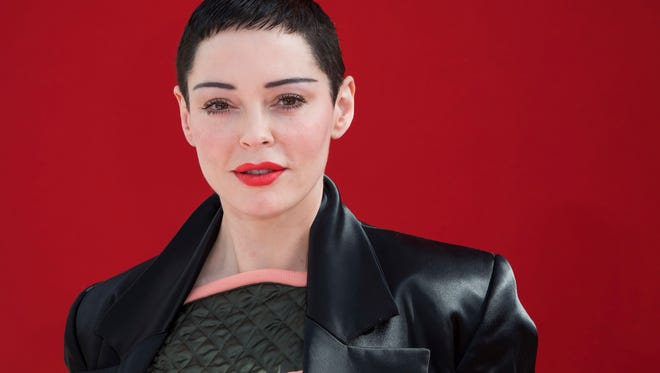Actress Rose McGowan poses for photographers before the Andreas Kronthaler for Vivienne Westwood show in Paris, Saturday, March 3, 2018.