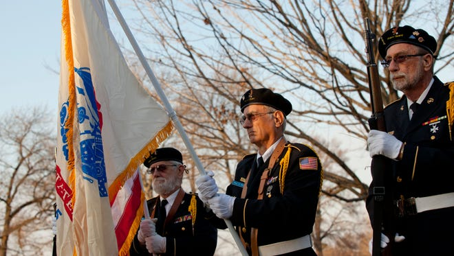Members of the St. Clair County Allied Veterans Affairs stand at rest during a ceremony at the grave site of Staff Sgt. Scott Lawson Wednesday, November 11, 2015 at Hillside Cemetery in St. Clair.