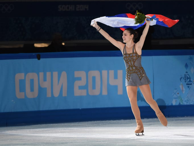 Adelina Sotnikova of Russia celebrates her gold medal in the ladies free skate program during the Sochi 2014 Olympic Winter Games.