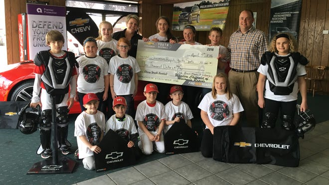 Mary Jo Wheeler and Dan Wheeler of Wheelers Chevrolet Buick GMC of Wisconsin Rapids present a check for $10,000 to the Wisconsin Rapids Youth Sports Association through the Chevrolet Youth Baseball program.
