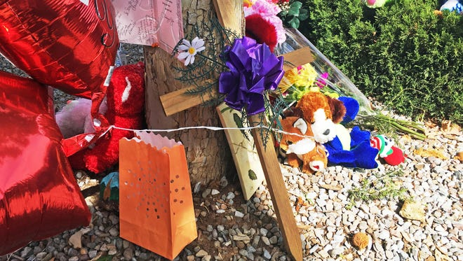 A memorial for a 10-year-old girl who police said was sexually assaulted, strangled then dismembered is seen at an Albuquerque apartment building Thursday. On the day the girl was going to celebrate her 10th birthday, she was found dead Wednesday in her family's apartment by Albuquerque police, her dismembered remains lying under a burning blanket. The girl's mother, 35-year-old Michelle Martens, her 31-year-old boyfriend, Fabian Gonzales, and his 31-year-old cousin, Jessica Kelley, are facing charges.