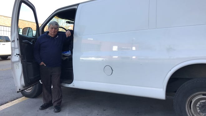 Robert Vigil stands with his 1999 Chevrolet 2500 cargo van, which is due to hit 1 million miles in the next few days.