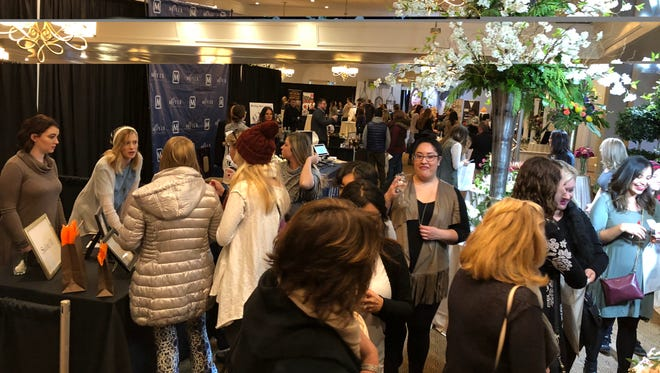 Despite the chilly weather, the Indianapolis Monthly Bridal Show drew a strong crowd to the Ritz Charles in Carmel on Sunday, Jan. 14, 2018.