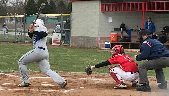 Pleasant catcher Zane Dine takes a pitch during a non-league baseball game against Wynford last week..As of April 9th, the Spartans had only played two games due to the weather.