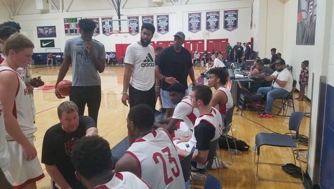Trendon Watford (far right), Ernest Watford (black T-shirt) and Christian Watford (white T-shirt) look on as Ernie Kuyper gives instructions to his Hoop City Basketball Club on Wednesday at the Las Vegas Summer Showcase.