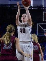 Community senior Lacey Reed elevates for a first-half jumper during Friday's Class A quarterfinal against South Greene.
