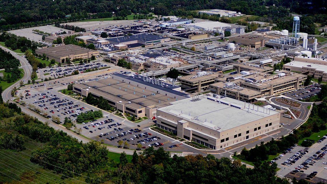 In this aerial photo looking northeast, IBM Building 323, foreground center left with dark roof, and it's annex, Building 323A, foreground center right with white roof, is where IBM manufactures its chips at the Hudson Valley Research Park in East Fishkill.