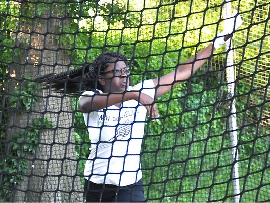 636004127810538025-New-Rochelle-freshman-Carrie-Ann-Calhoun-watches-her-hammer-throw-during-the-girls-Section-1-championships..jpg