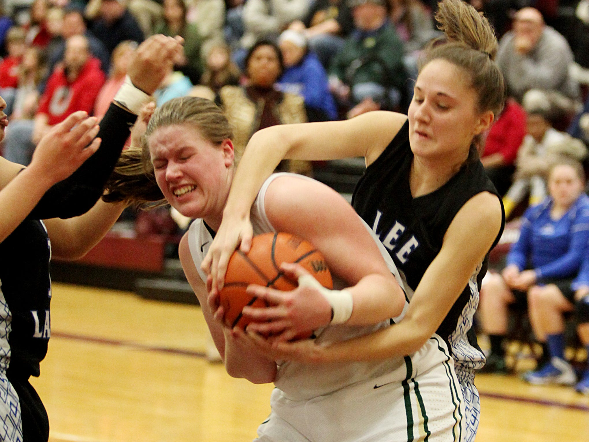 Wilson Memorial's Leara Shumate fights for the ball with Robert E. Lee's Jesse Bartley during their Group 2A East semifinal game at Stuarts Draft High School on Saturday.