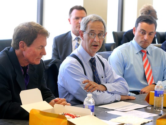Joel Seligman attends a Finger Lakes Regional Economic Development Council committee meeting. With him is Danny Wegman and Vincent Esposito of Empire State Development.