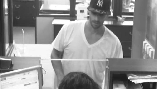 A still from surveillance footage of the robbery at Santander Bank in Middletown on Friday afternoon.