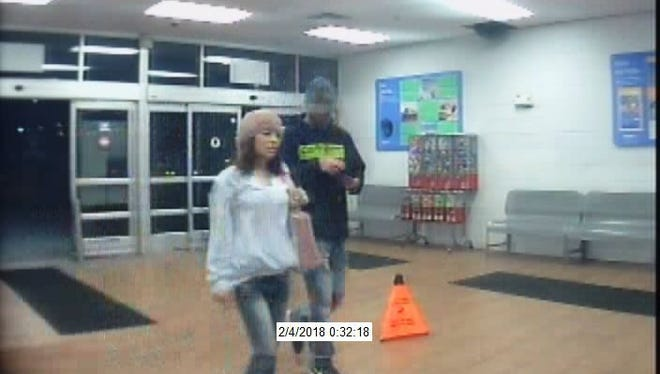 Surveillance video of pair wanted for allegedly making illegal purchases with a credit card.