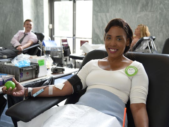 LaDeodra Drummond donates blood at the Rayburn House