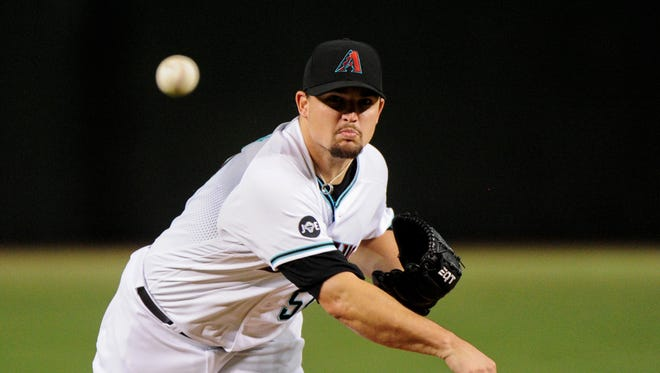 Jul 19, 2016: Arizona Diamondbacks pitcher Zack Godley (52) throws against the Toronto Blue Jays during the first inning at Chase Field.