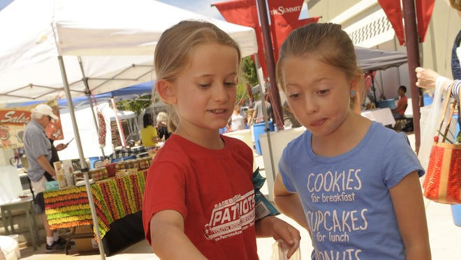 Two young produce enthusiasts at the summer 2016 farmers market at the Summit.