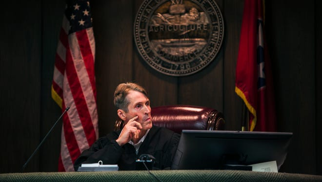 Judge Mark Ward listens to proceedings in his courtroom in an unrelated case in 2017.