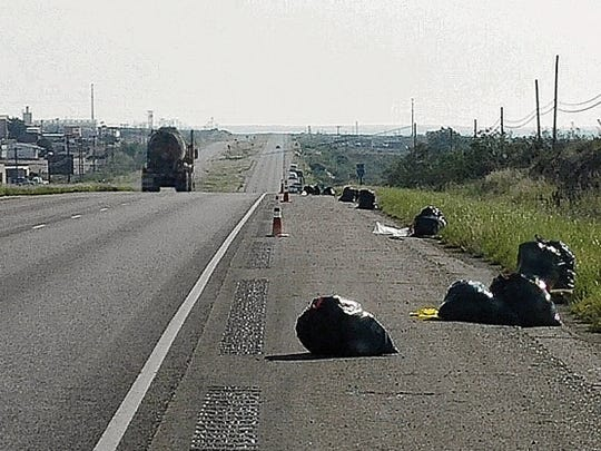 Trash collected by volunteers awaits pick-up along Hobbs Highways on Saturday. More than 3,000 pounds of trash were gathered.