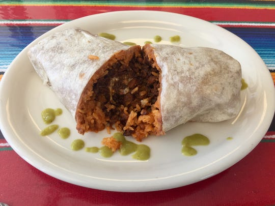 Beans and rice join pastor in a burrito at Carmelita's Taqueria.