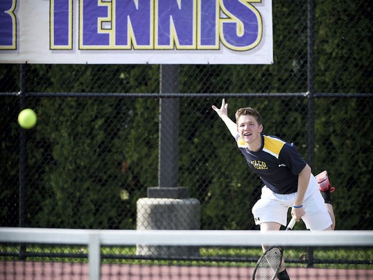 Elco's Galen McNaughton, launches a serve during his No. 2 doubles win with Christian Stahl against Lancaster Mennonite on Monday. McNaughton was also victorious in singles, but Elco fell to Mennonite, 5-2, for its first loss of the season.