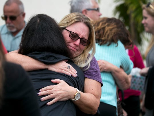 Nadine Maki gets a hug at the Gift of Life ceremony for her son Erik Babatz on Tuesday at Lee Memorial Hospital. Babatz, a cross-country runner at Fort Myers High School, was declared brain dead after being involved in a car crash on Saturday night. His family is donating his organs.