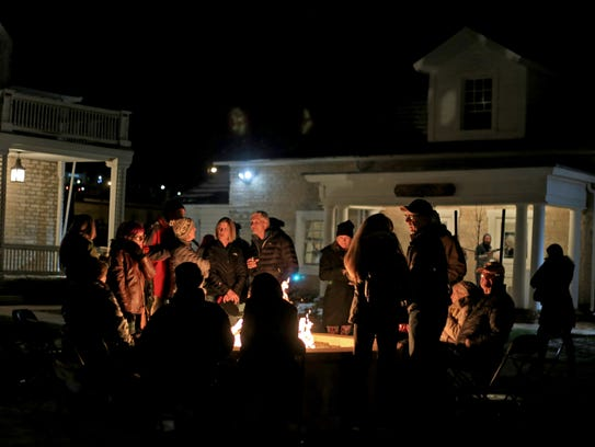 Georgefest patrons gather around a fire pit Friday