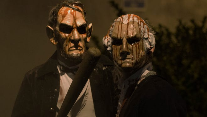 Killers in presidential masks give a creepy edge to the politically tinged horror film 'The Purge: Election Year.'