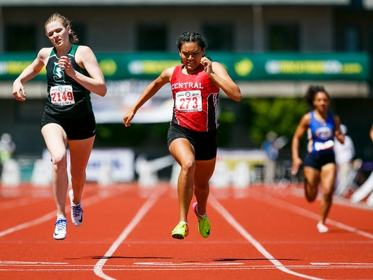 Central's Bethanie Altamirano crosses the finish line in first, just ahead of Summit's Sarah Reeves, in the 5A 400 meter dash at the 2017 OSAA track and field state championships on Saturday, May 20, 2017, at Hayward Field in Eugene, Ore.