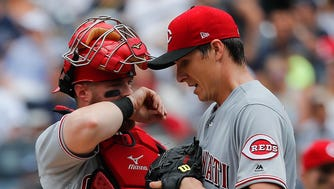 Cincinnati Reds catcher Tucker Barnhart talks with starting pitcher Homer Bailey (34) during the third inning of a baseball game against the New York Yankees, Wednesday, July 26, 2017, in New York.