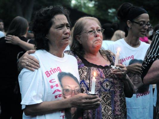 635707675869097479-062415missing-vigil