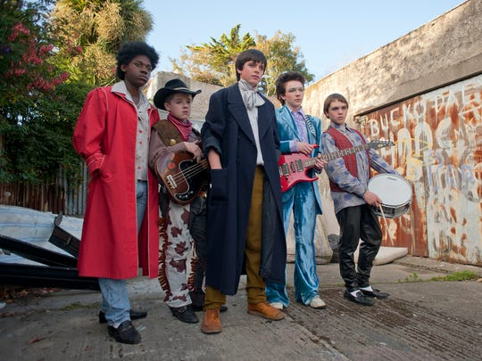 Conor (Ferdia Walsh-Peelo, center) gets a band together to impress a girl in 'Sing Street.'
