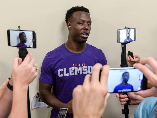 Clemson running back Travis Etienne (9) answers questions
