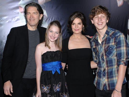 From left, Howard Sherman, Annabella Sherman, Sela