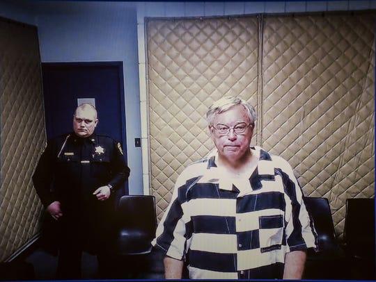 Roman Catholic priest Robert DeLand is arraigned Monday,
