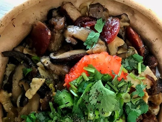 A clay pot rice dish from Pho Fresh in south Fort Myers.