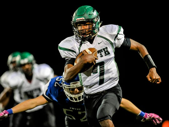 South Plainfield quarterback Charles Lovett scrambles against Ewing in the Central Jersey Group III football playoff semifinal in Ewing on Fri. Nov. 18, 2016.
