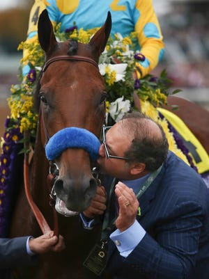 Owner Ahmed Zayat kisses American Pharoah after he won the Breeders' Classic.   