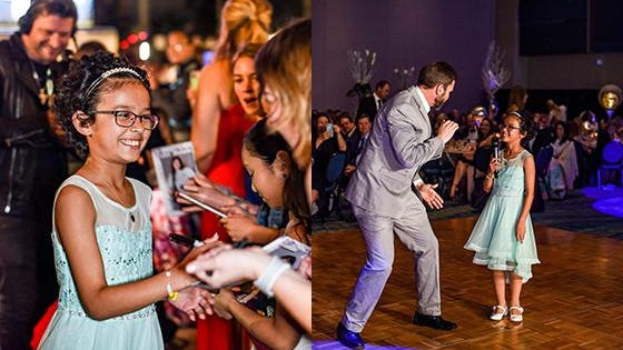 Jupiter's Maja Milovanovic signs autographs on the red carpet at the Stars Ball and is entertained by some dance moves from Kevin Rolston from the KVJ Show at the Little Smiles Ball, Feb 1. 2020.