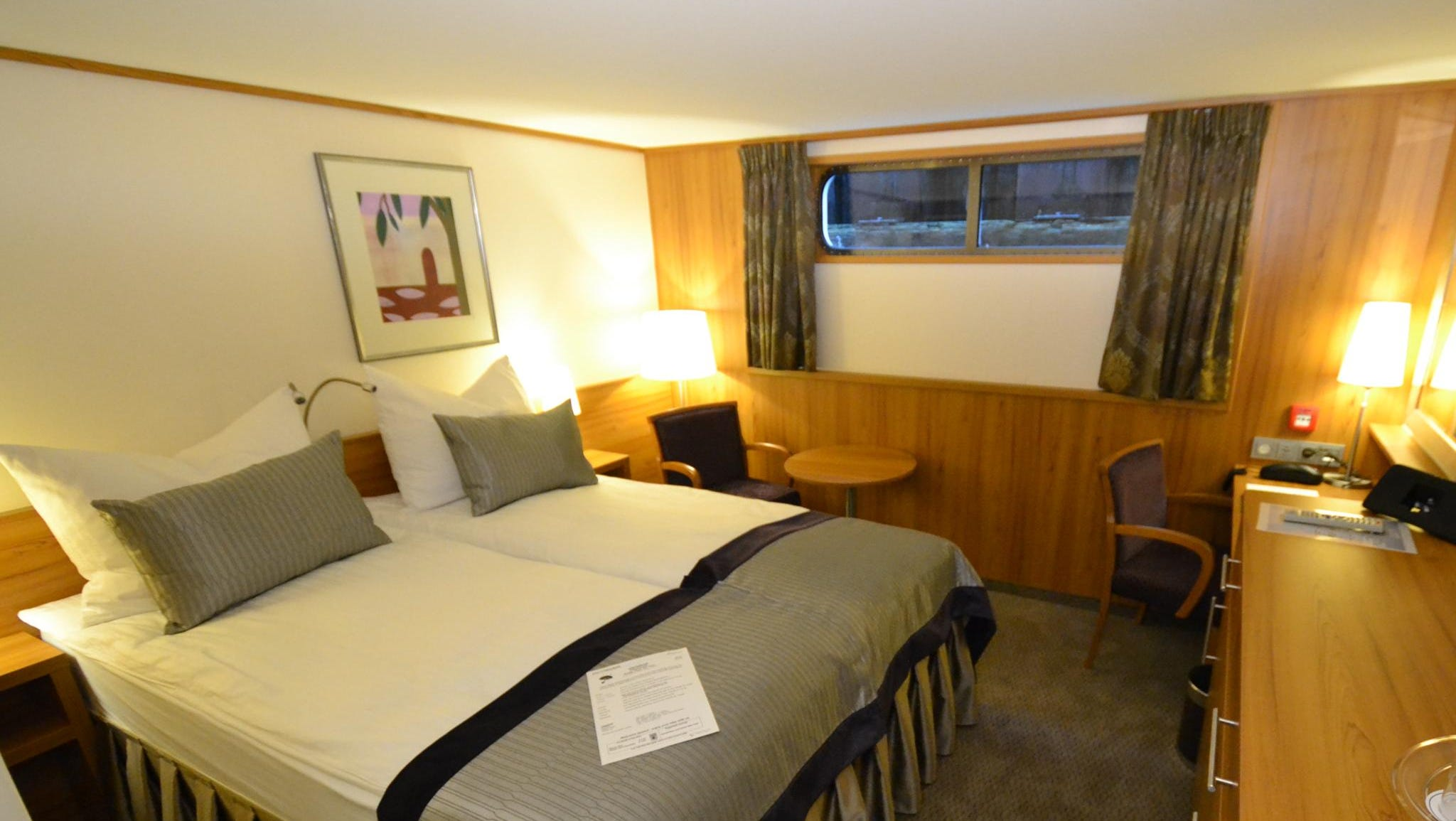 Standard cabins on the ship, such as the one shown here, are 165 square feet. Most have French balconies looking out over the water, though some standard cabins on the ship's lowest desk (such as this one) only have windows.