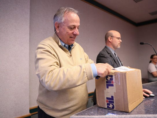 Premont Superintendent Steve VanMatre opens the box