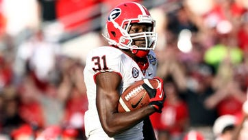 Georgia wide receiver Chris Conley (31), who scored this touchdown last season against Nebraska during the Capital One Bowl, will face the Cornhuskers again on Jan. 1 in the Gator Bowl.