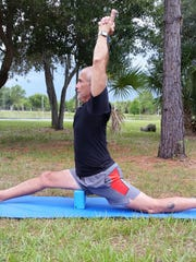 Gary Granza of Ruby and Pearls and Bija Yoga holds Monkey Pose.
