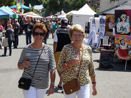 Enjoying the sunshine and wine on Main Street, Salinas